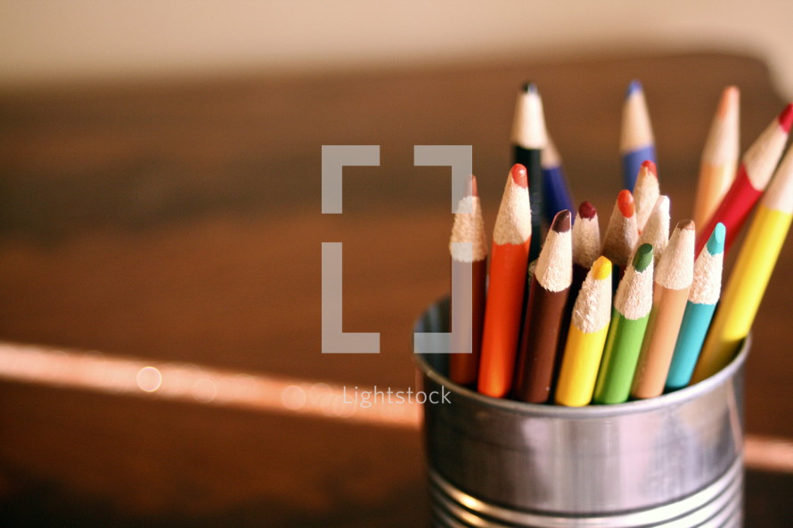 cup of colored pencils