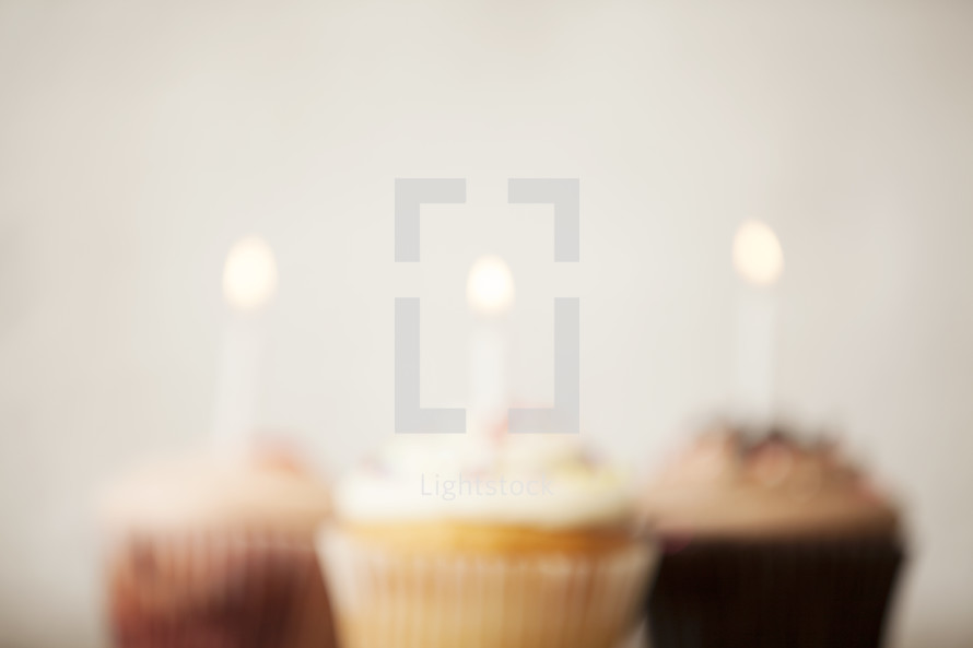 blurry cupcakes and candles