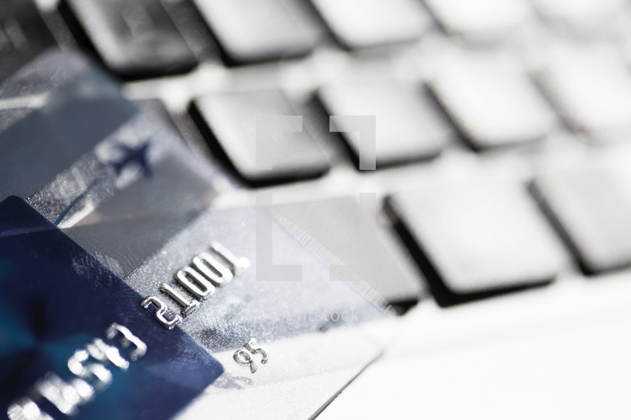 closeup of a credit card on a laptop keyboard.