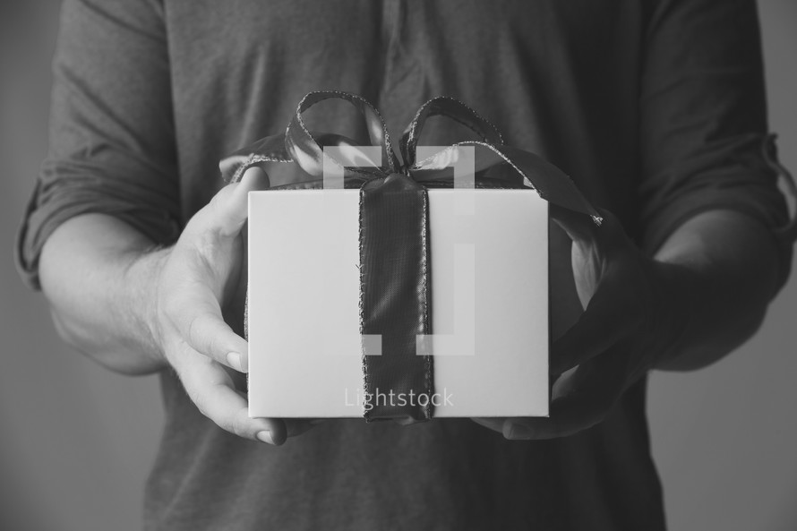 man handing a gift. black and white