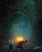 a man laying a road down