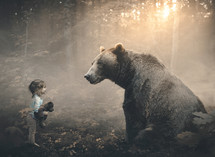a little girl with a bear in a forest