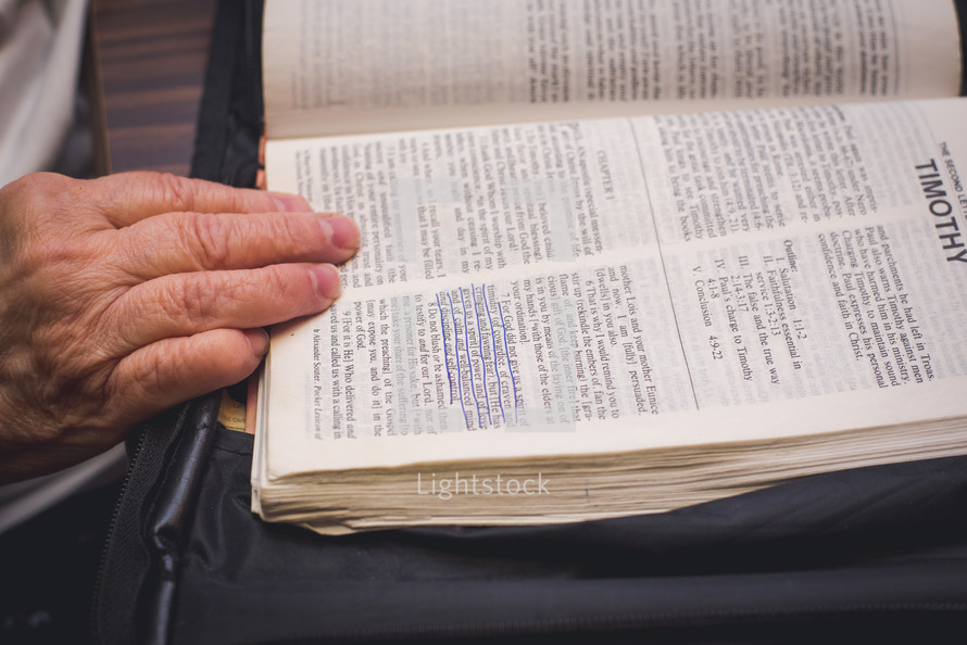 elderly woman reading a Bible