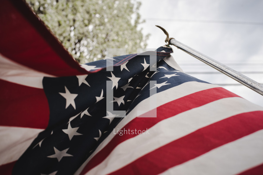 American flag and spring blossoms