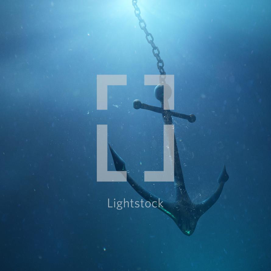 An anchor sinks down through the water