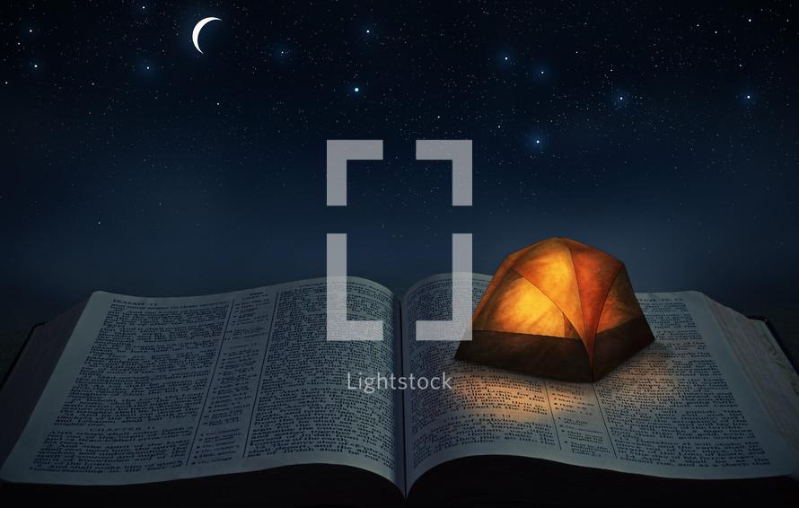 a tent on an open Bible