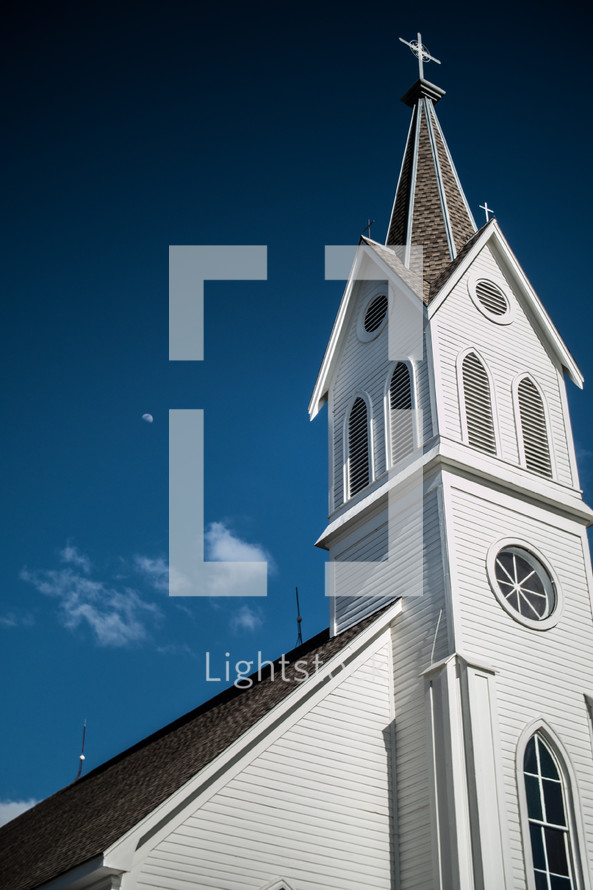 moon over a church steeple