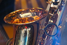 Close up of a brass saxophone.