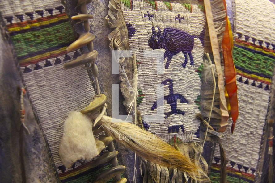 Native American clothing feathers beads chief indians cowboys wars wigwam bow arrow tomahawk buffalo Apache,  Sioux  Cheyenne,  Shoshone,  Pawnee people,  Osage Nation,  Navajo,  Ute people,  Ponca,  Otoe,  Ho-Chunk,  Modoc people,  Comanche  Quechan,  Omaha people,  Missouria,  Meskwaki.  Chemehuevi Washoe people Miami people Arikara Karuk Confederated Salish and Kootenai Tribes of the Flathead Nation Goshute Sac and Fox Nation Cahto Hidatsa Timbisha Pascua Yaqui Tribe Shawnee Tribe Mandan Iowa people