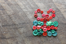 red and green buttons on a wood background