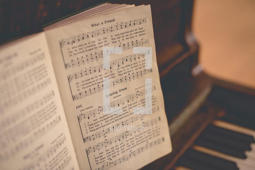 Amazing Grace sheet music on a piano