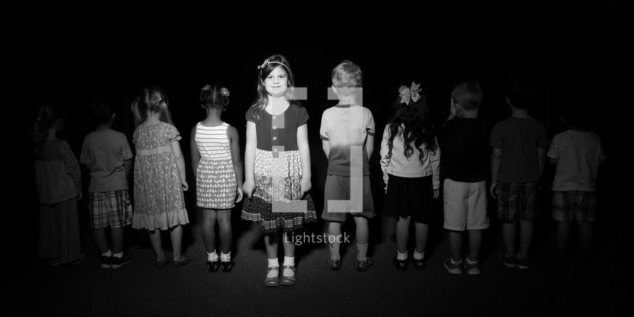 young children standing in line