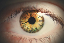 An eye with a clock face on the iris.