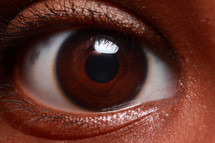 extreme macro of a brown eye of an Ethiopian child