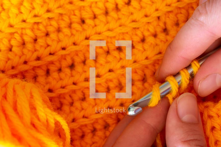 knitting orange yarn