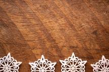 white felt snowflakes border on wood