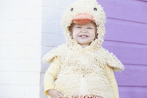 child in a duck costume