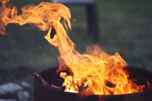 Close up shot of blurred flames in a campfire.