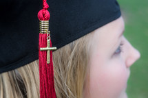 Graduate with cross on her tassle.