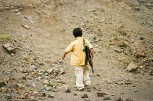 a child carrying a gun for his family as they return from recreational shooting