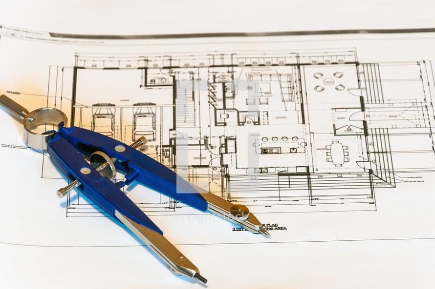 blueprints and a compass