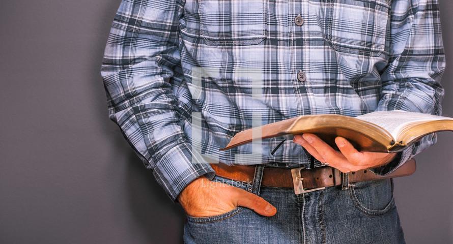 Man reading an open bible