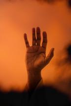 raised hand of Christ