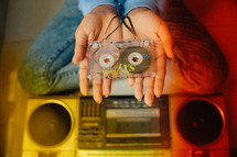 a woman holding a cassette tape