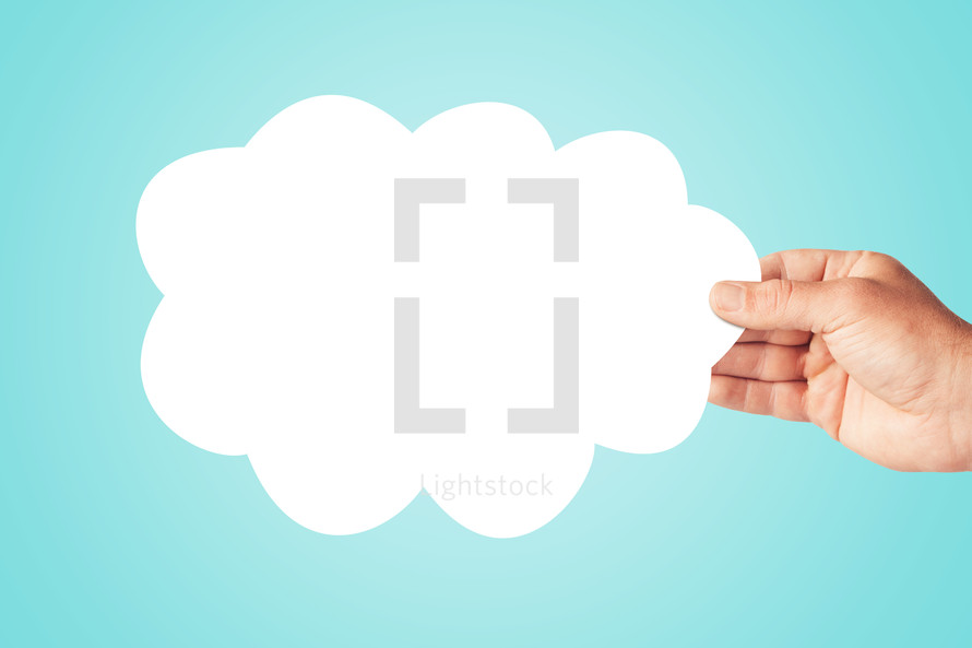 hand holding a paper cloud.