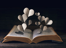 hearts over the pages of a Bible