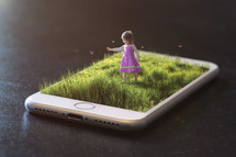 a child playing outdoors - image on an iPhone screen