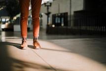 man's legs illuminated by sunlight