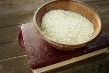 bowl of rice on a bible