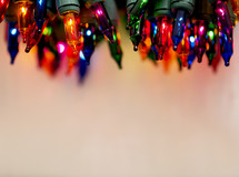 close up of colored Christmas lights border.