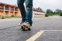 feet of a young man on a skateboard