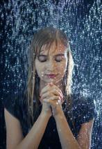 a woman praying in the rain