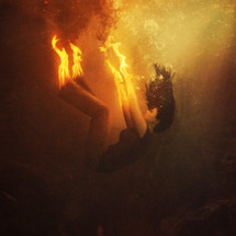 a woman on fire under water