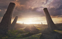 A man walks through a surreal landscape with large towers