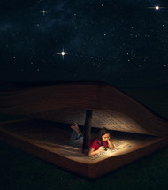 camping with a Bible tent under the night sky