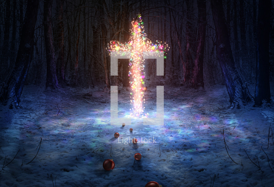 christmas lights on a cross in snow