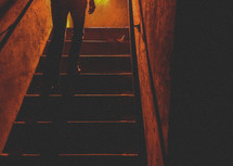 woman walking up stairs in the dark