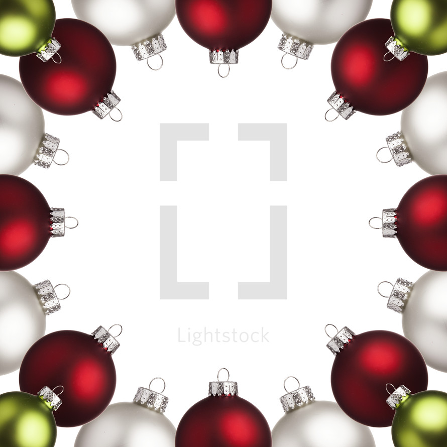 border of Christmas ornaments with copyspace in the middle.