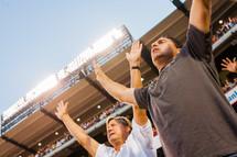 Praising God in a stadium Christ crusade men