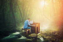 A man is playing a piano in the middle of a forest