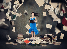 a woman surrounded by books