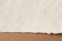 Edge of rag paper.