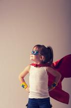 Girl in a superhero costume.