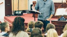 worship leader speaking to children