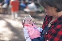 a grandmother holding a newborn baby