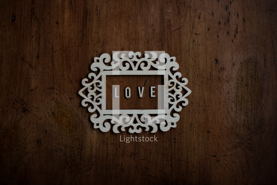 word Love in a frame